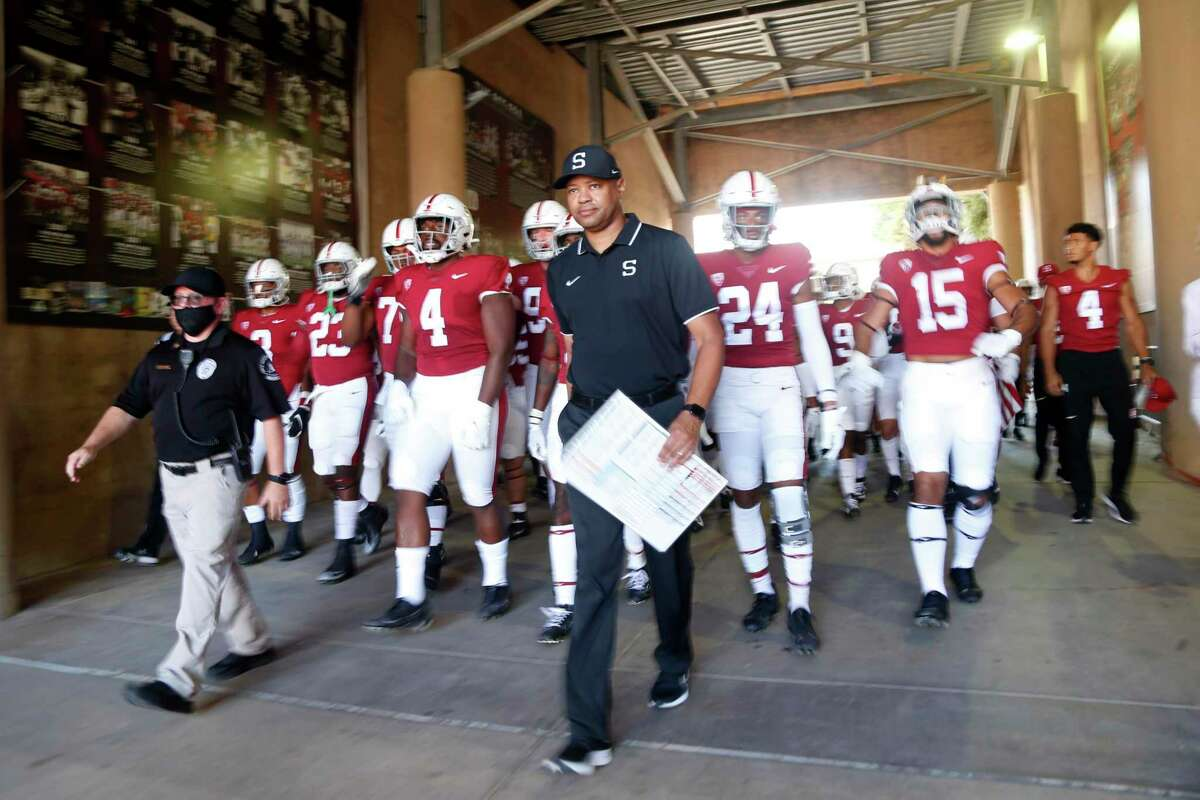 Stanford head coach David Shaw enters the field with his team against Oregon at an NCAA college football game in Stanford, Calif., Saturday, Oct. 2, 2021. (AP Photo/Jed Jacobsohn)