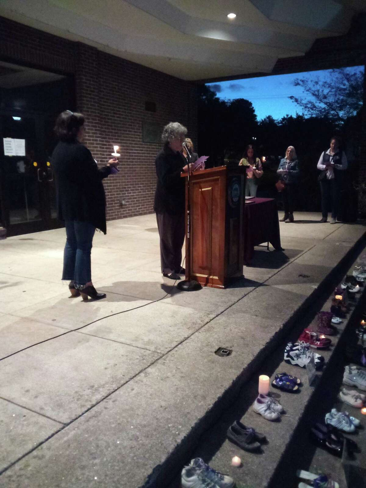 The Susan B. Anthony Project held its annual domestic violence awareness vigil Wednesday night at Coe Memorial Park.