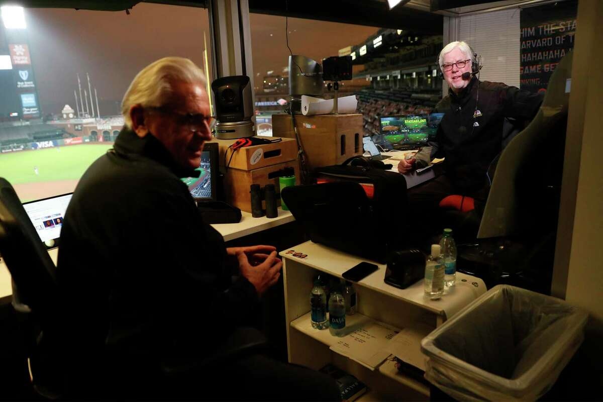 San Francisco Giants broadcasters Mike Krukow, right, and Duane Kuiper before an MLB game at Oracle Park in San Francisco in September 2020.