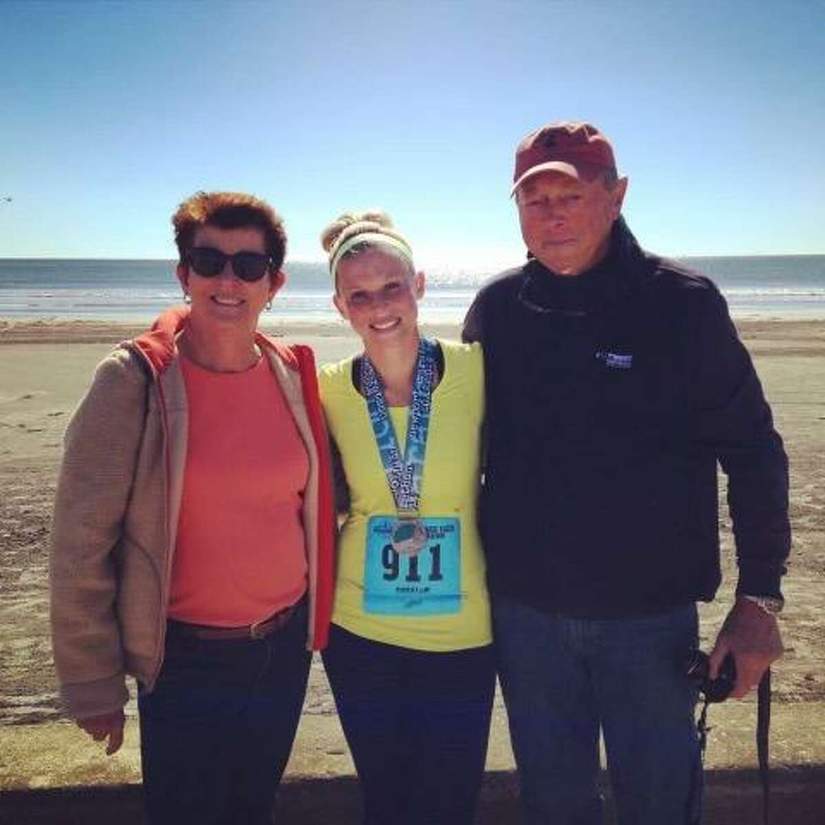 Lea Aruilio, center, with her mother Cindy Swanson and father Eric Swanson at the 2014 Newport Marathon.