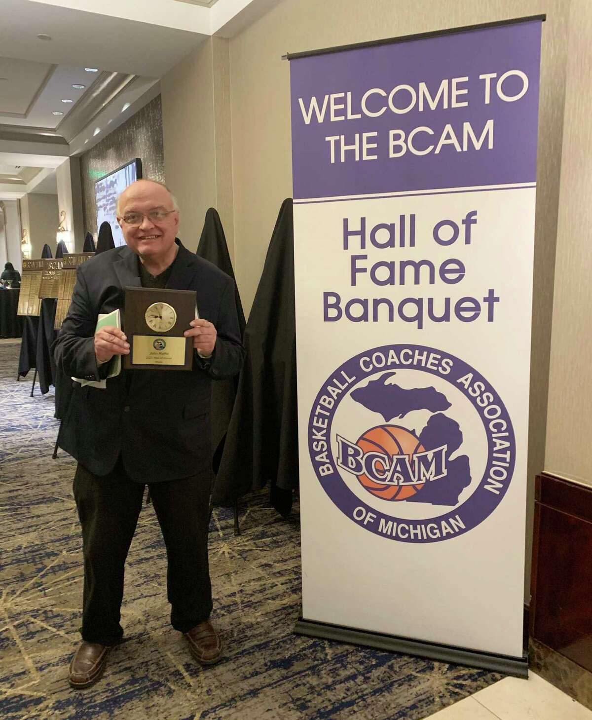 Pioneer sports director John Raffel displays a commemorative plaque he received from theBasketball Coaches Association of Michigan. Raffel was inducted into the BCAM's Hall of Honor during a special banquet Oct. 2 for his dedication of sports coverage throughout the state of Michigan over the years. (Courtesy photo)