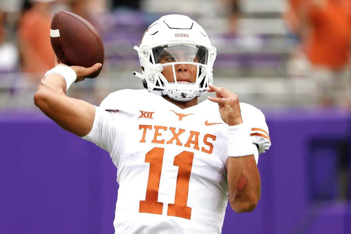 Texas quarterback Casey Thompson (11) warms up before playing TCU in an NCAA college football game Saturday, Oct. 2, 2021, in Fort Worth, Texas. (AP Photo/Ron Jenkins)