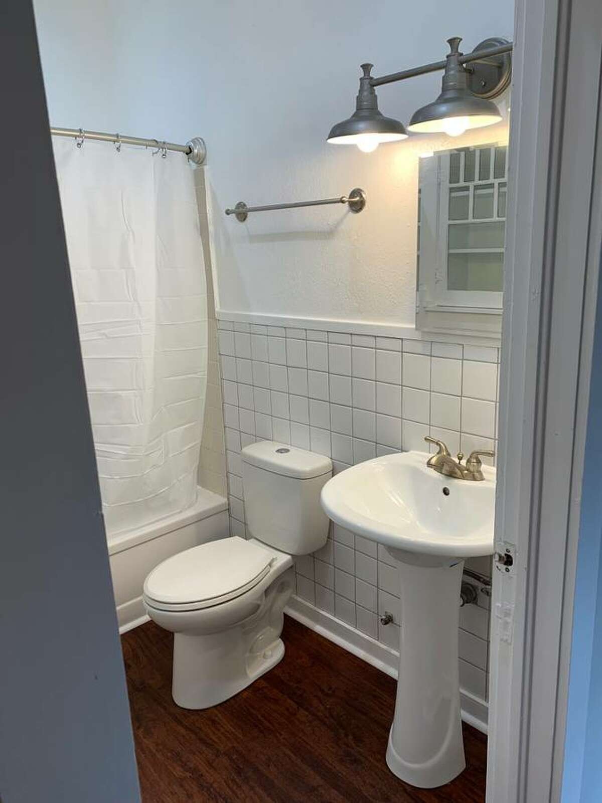 The white tiles and the pedestal sink - it's a pretty bathroom.