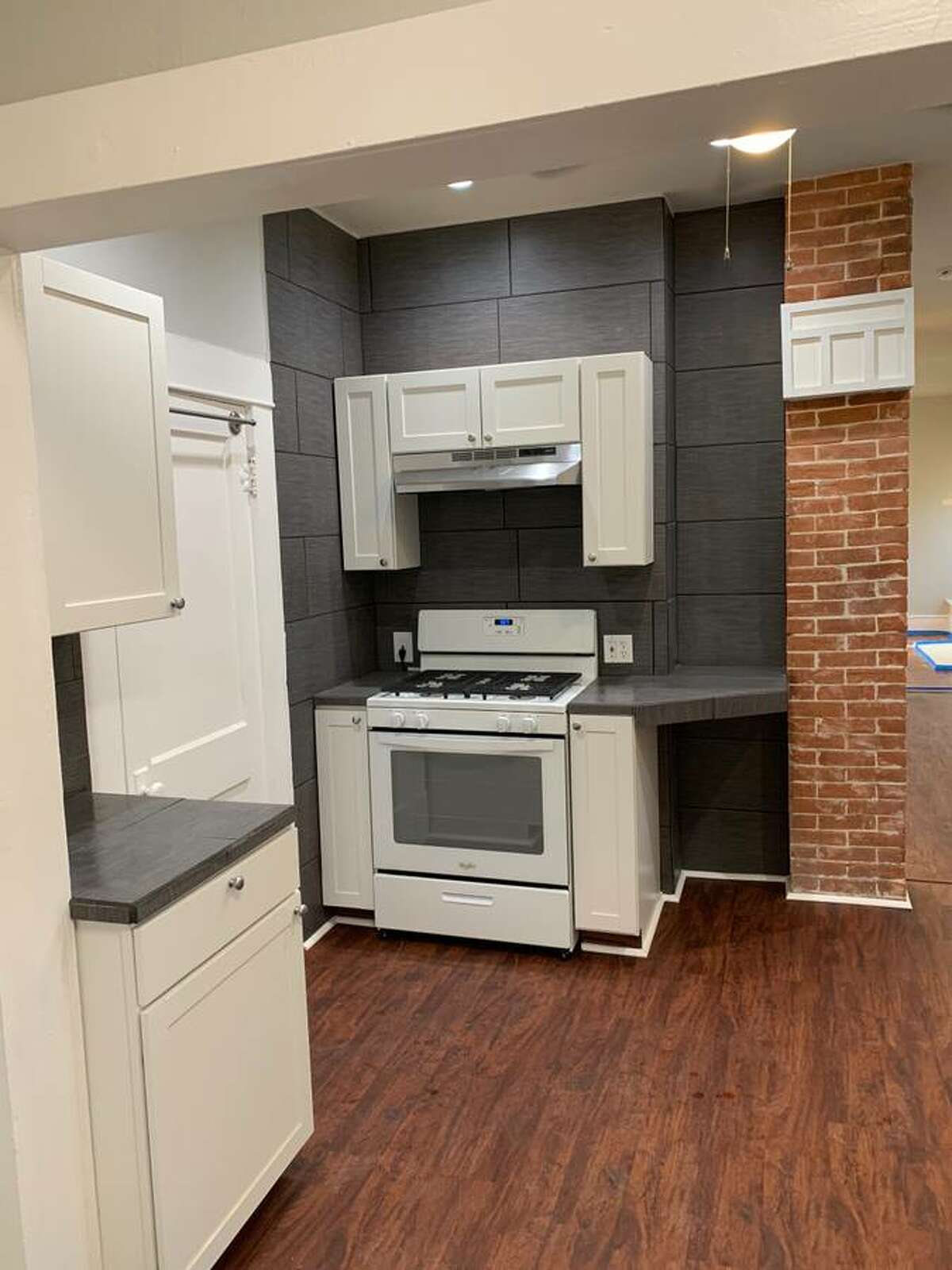 Here's a look at the stove, which has a floor-to-ceiling backsplash.