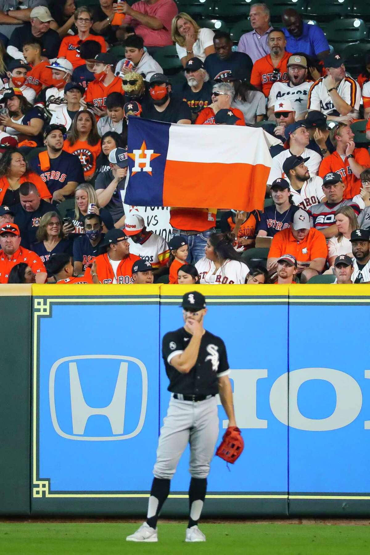 Astros fans cheer as Chicago White Sox right fielder Adam Engel (15) stands in right field during the third inning in Game 1 of the AL Division Series Thursday, Oct. 7, 2021, in Houston.