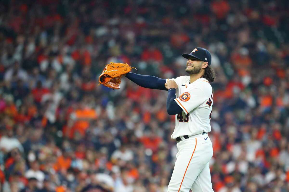 Houston Astros starting pitcher Lance McCullers Jr. (43) walks back to the mound after throwing out Chicago White Sox right fielder Adam Engel (15) during the third inning in Game 1 of the AL Division Series Thursday, Oct. 7, 2021, in Houston.