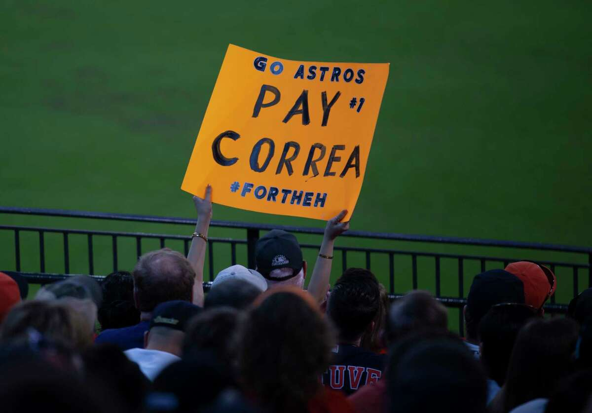 A Houston Astros fan holding a Carlos Correa sign at Game 1 of the AL Division Series against Chicago White Sox Thursday, Oct. 7, 2021, in Houston.