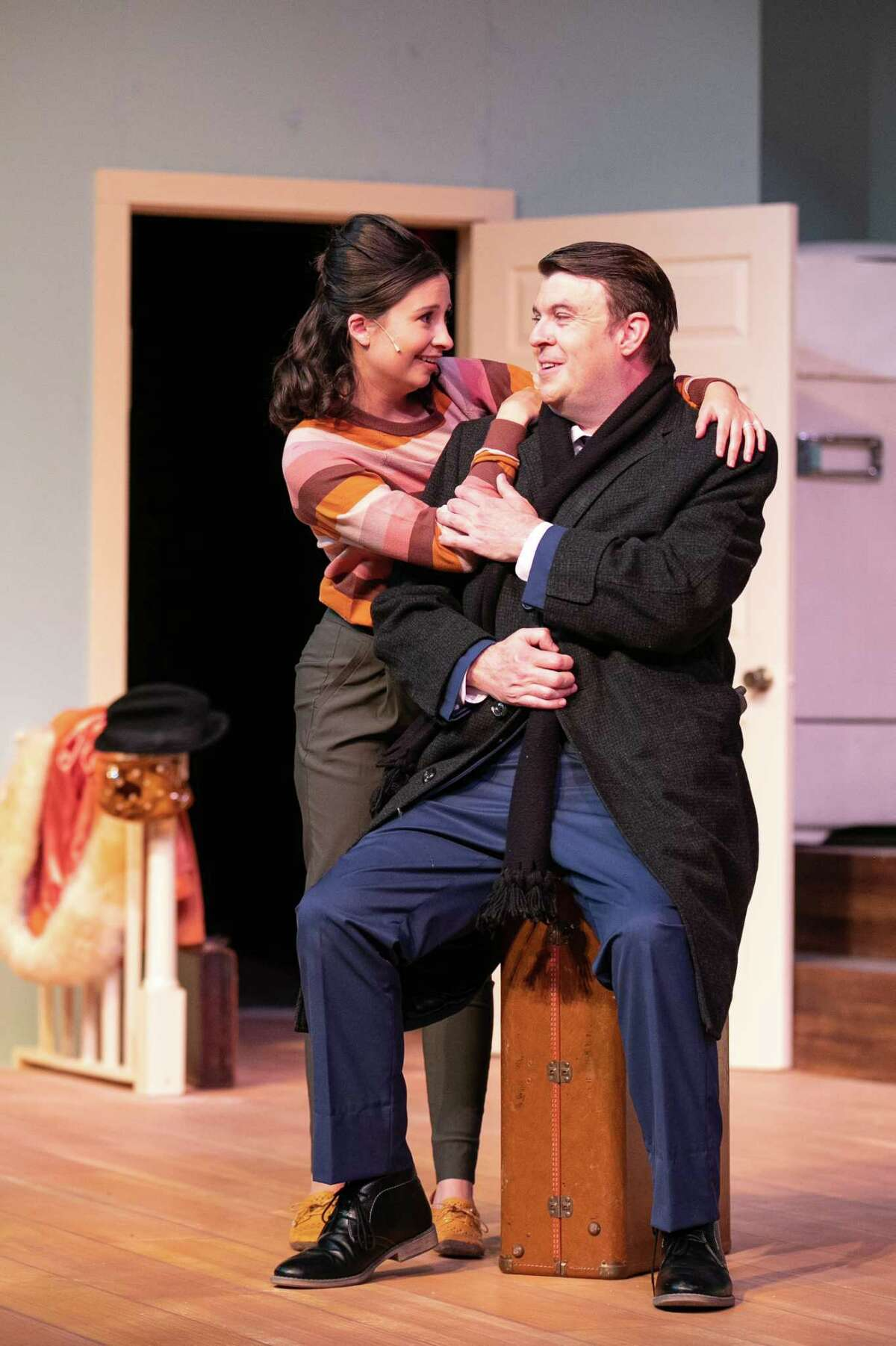 """Newlyweds Corie (Sarah Turner) and Paul (Kevin Leoffler) sit in their new, unfurnished, fifth floor apartment during dress rehearsal for Midland Community Theater?•s ?'Barefoot In The Park?"""" October 5, 2021 at MCT. MANDATORY CREDIT: The Oilfield Photographer, Inc."""