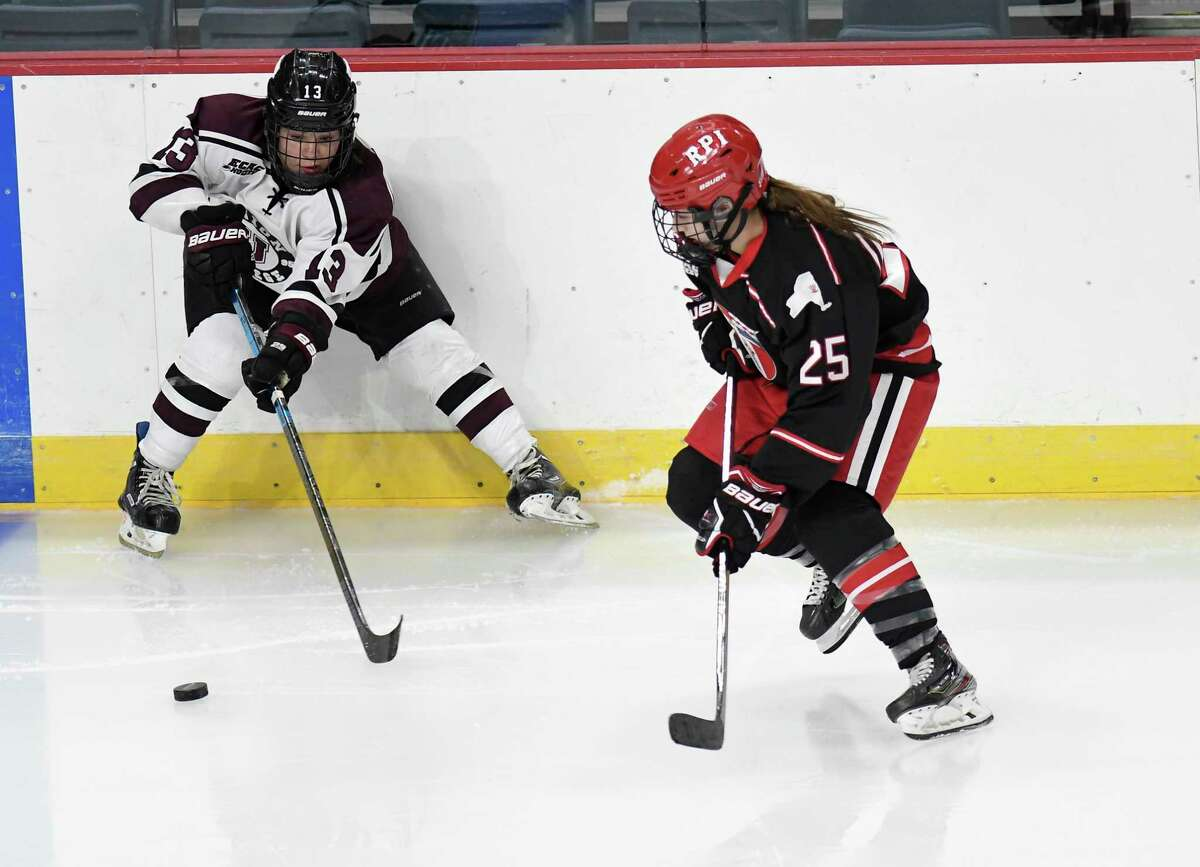 Union forward Emily King, left, and RPIforward Sarah Bukvic chase the puck during the teams' meeting in 2020. Both are back for this year's games.