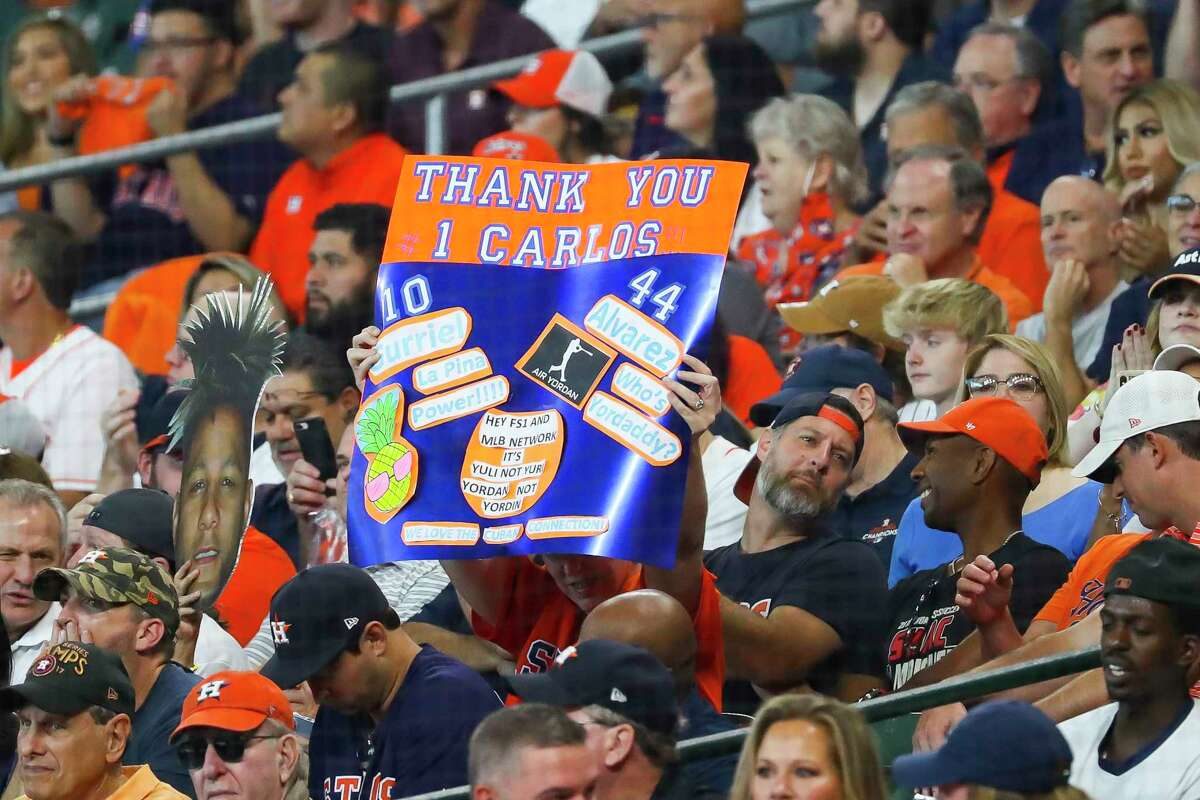 Fans hold a sign for Houston Astros shortstop Carlos Correa (1) during the second inning in Game 1 of the AL Division Series Thursday, Oct. 7, 2021, in Houston.