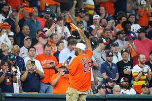 """Bun B makes the """"play ball"""" call before the first inning in Game 1 of the AL Division Series Thursday, Oct. 7, 2021, in Houston."""