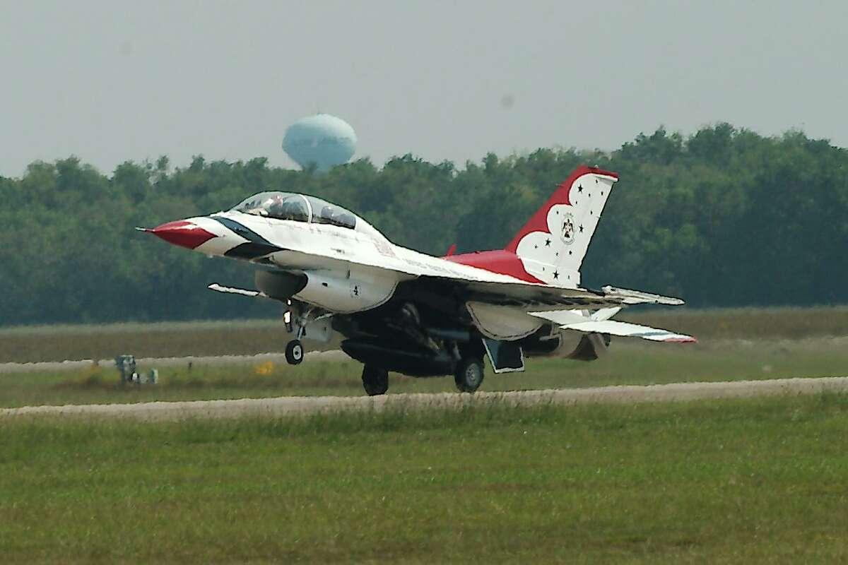 A jet with the U.S. Air Force Thunderbirds arrives at Ellington.