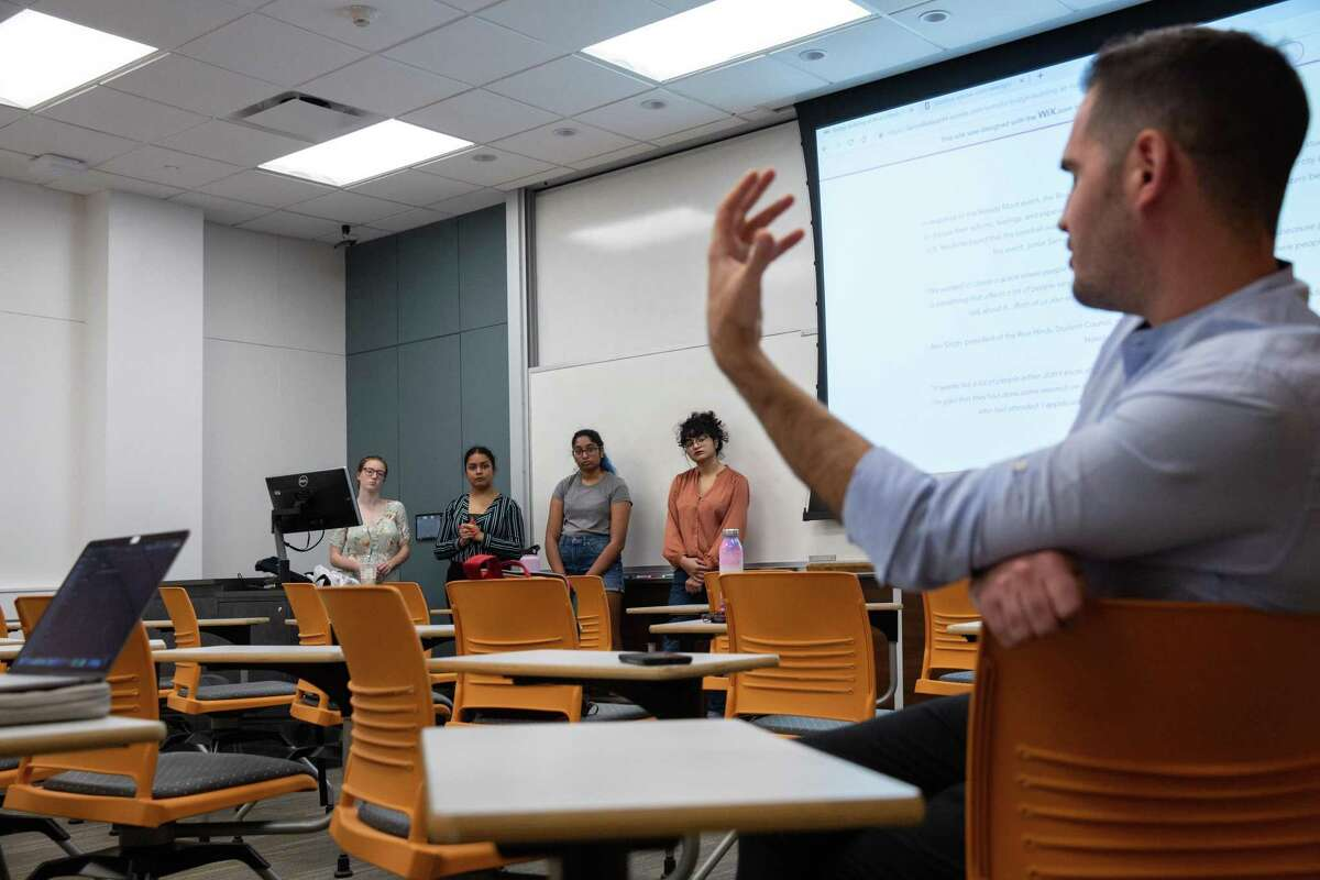 Rice University lecturer Dr. Craig Considine directs a question to his students after presenting their research on Hindu and Muslim relations for his class on Nov. 26, 2019.