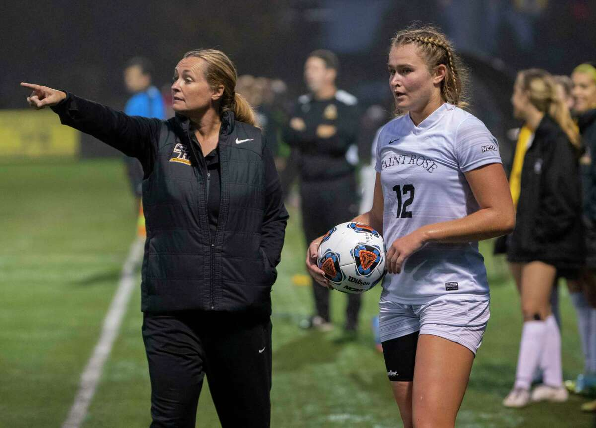 St. Rose women's soccer coach Laurie Darling Gutheil is seen on the sideline as Mia Klammer, #12, gets ready to inbound the ball during a game against St. Michael's at Plumeri Sports Complex on Tuesday, Oct, 5, 2021 in Albany, N.Y.