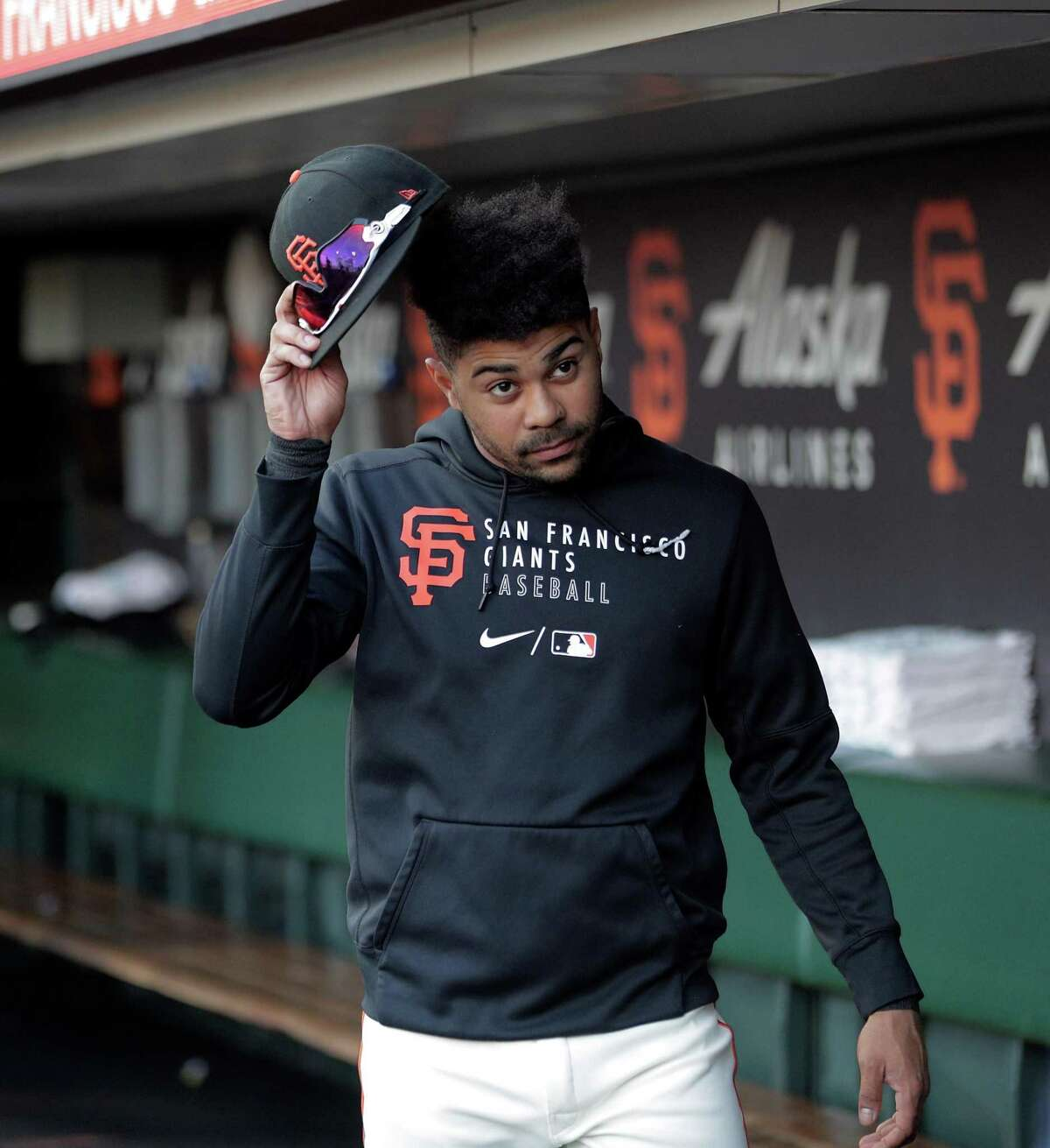 LaMonte Wade Jr. (31) in the dugout before the San Francisco Giants played the Los Angeles Dodgers at Oracle Park in San Francisco, Calif., on Wednesday, July 28, 2021.