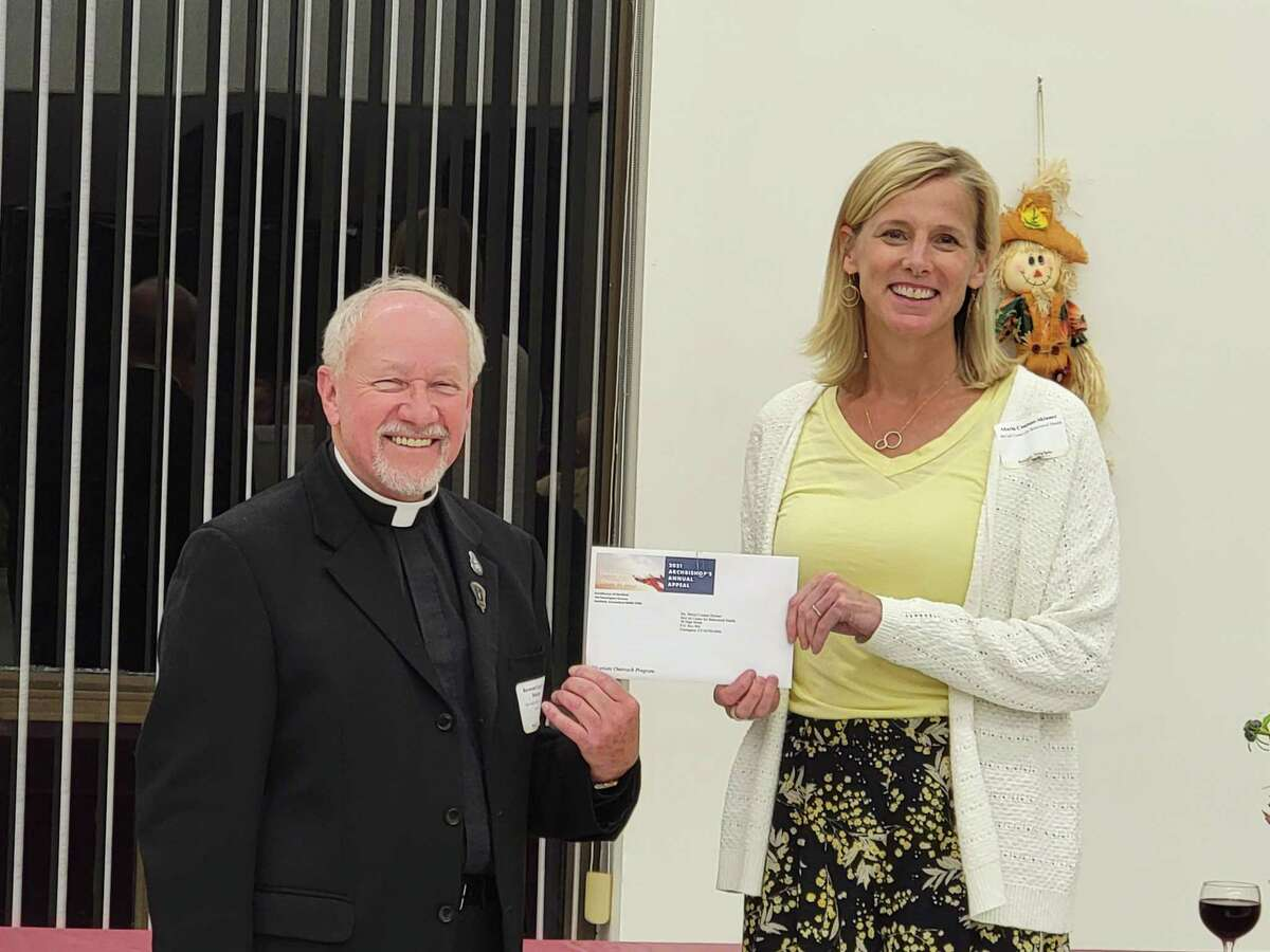 McCall Center for Behavioral Health in Torrington recently received a check in the amount of $15,000 from the Archbishop's Annual Appeal through its Vicariate Outreach Program. Pictured is McCall executive director with a representative from the Archdiocese of Hartford.