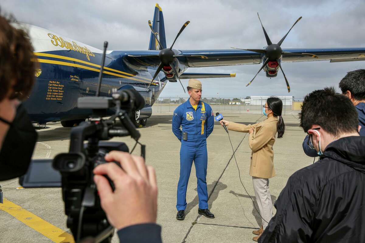 United States Navy Blue Angels officer Rick Rose answers questions during a press meet-and-greet at Signature Flight Support at Oakland International Airport on Thursday.
