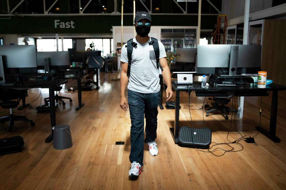 Daniel Carter leaves the Fast office to walk a few blocks to his home after working in person in San Francisco, Calif. Thursday, August 26, 2021. Carter lives a few blocks from Fast and walks to and from work on the days he chooses to work in the office.