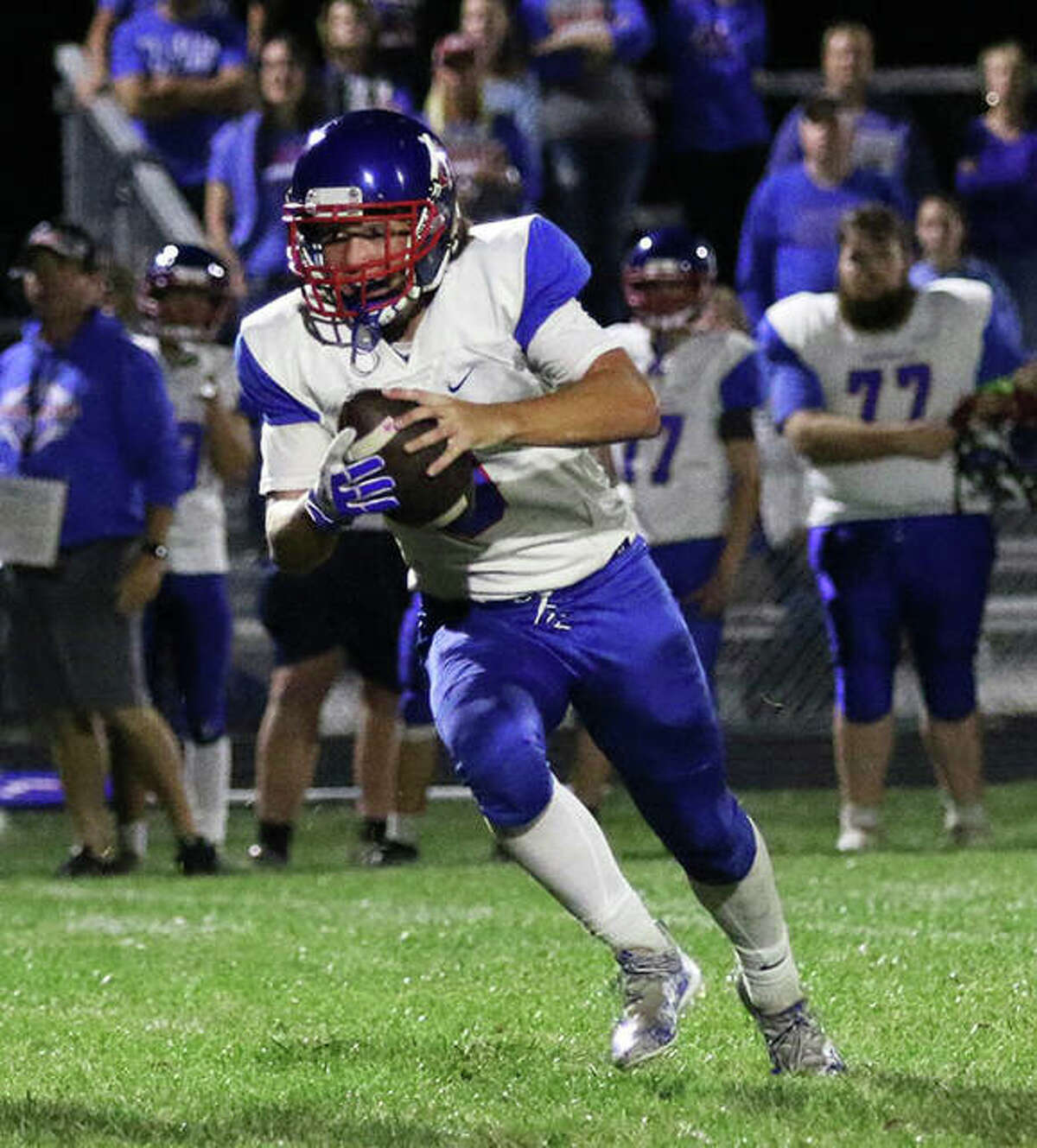 Carlinville quarterback Ayden Tiburzi looks for running room in last Friday's SCC football game against Southwestern at Knapp Field in Piasa.