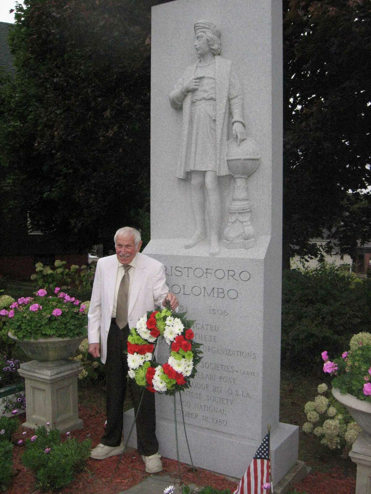 Albert Persechino, Torrington's 2019 Italian Mayor of the Day, stands in front of the Christopher Columbus monument.