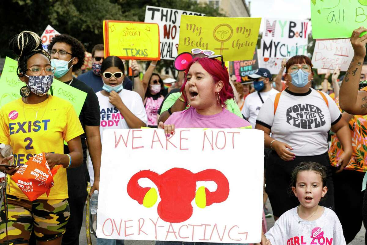 """People march through Downtown San Antonio, Texas, as they participate in the """"Ban Off Our Bodies"""" abortion rights march Saturday afternoon, Oct. 2, 2021. It was one of more than 600 planned abortion rights rallies taking place in cities across all 50 states Saturday."""