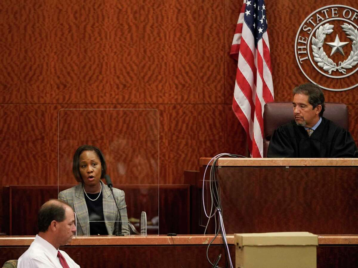 Paulette Jackson, sister of Dwayne Jackson, gives her victim impact statement in the Harris County Court of Judge Chuck Silverman Thursday, Oct. 7, 2021 in Houston after the trial of David Conley, who was sentenced to life in prison without the possibility of parole for killing Valerie Jackson and Dwayne Jackson. The couple were killed on Aug. 8, 2015 along with six children- Nathaniel, 13, Honesty, 11, Dwayne Jr., 10, Caleb, 9, Trinity, 7, and Jonah, 6.