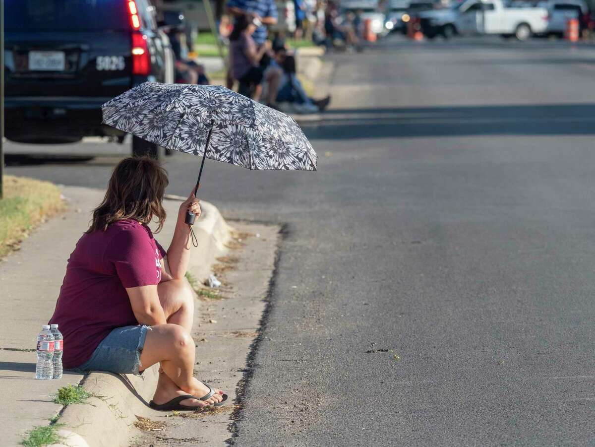 LHS supporters who could not find shade to sit in brought out umbrellas to keep the sun off of them as temperatures hovered around 95 degrees 10/07/2021 as the homecoming parade makes its way toward the school. Tim Fischer/Reporter-Telegram