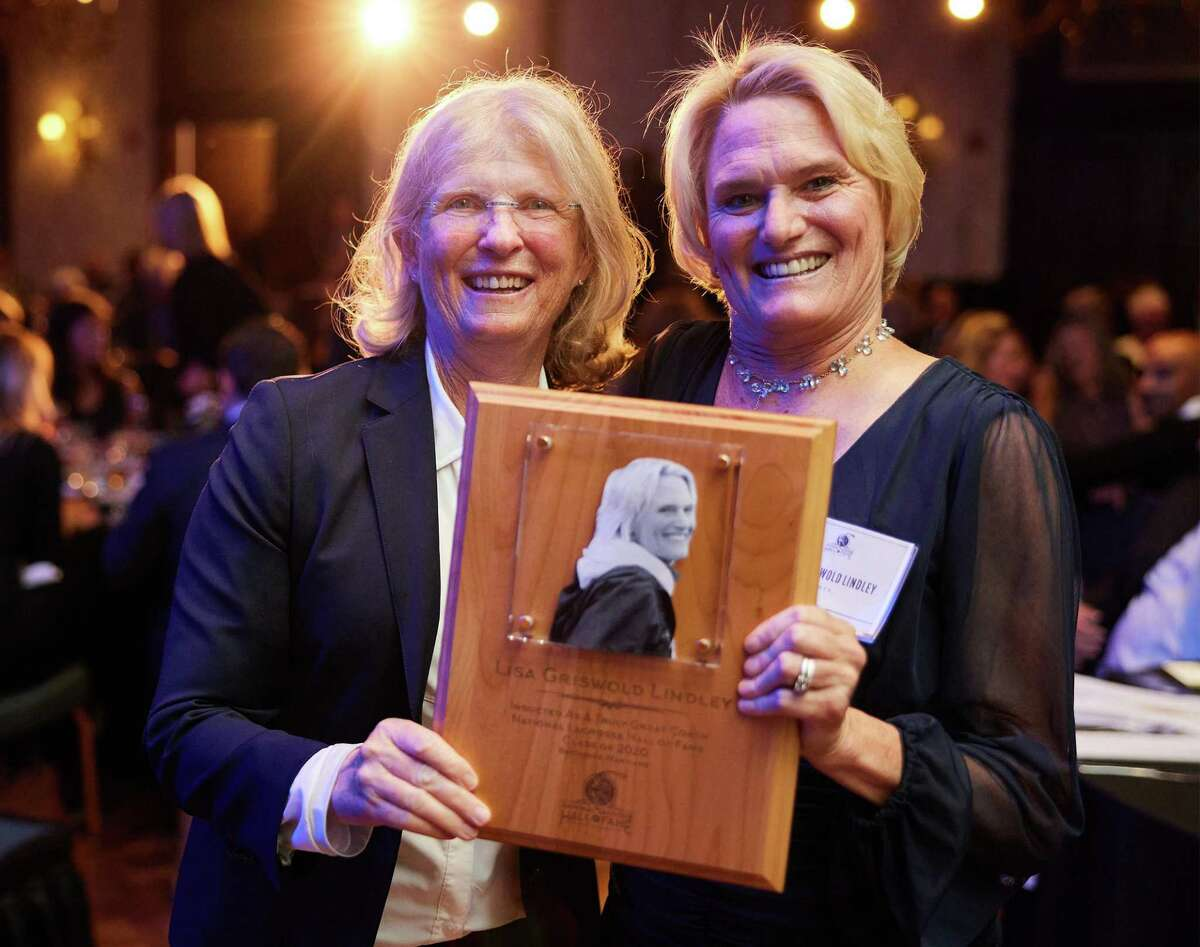 Darien girls lacrosse coach Lisa Lindley (right) with Navy women's lacrosse coach Cindy Timchal after Lindley was inducted into the National Lacrosse Hall of Fame at The Grand Lodge in Hunt Valley, Md., on Saturday, Oct. 2, 2021.