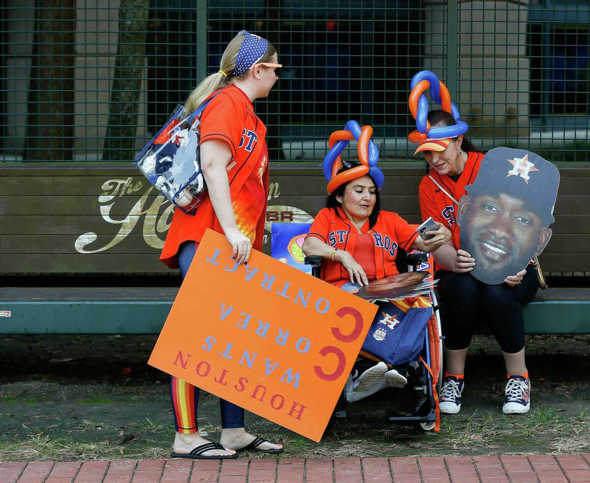 Fans participate in FanFest before game 1 of the American League Division Series between the Houston Astros and the Chicago White Sox at Minute Maid Park on Thursday, Oct. 7, 2021, in Houston.
