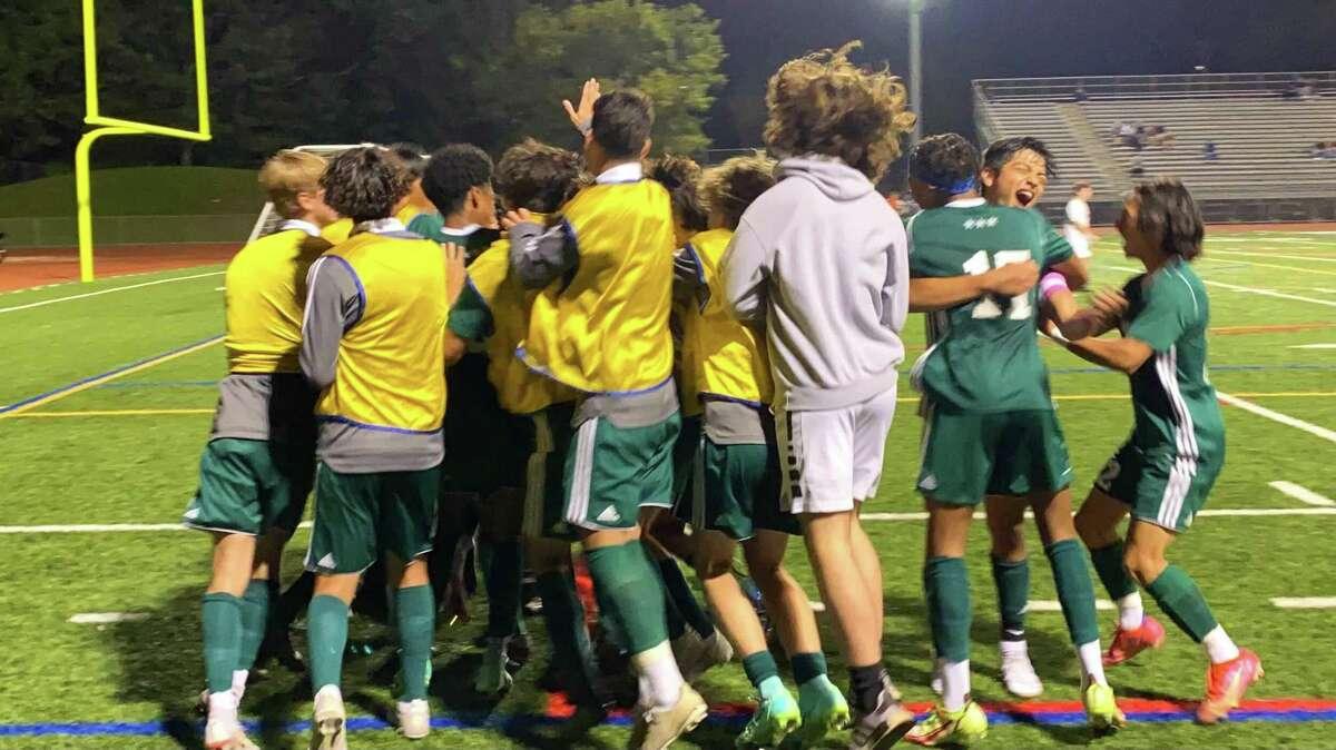 Members of the Norwalk boys soccer team celebrate their win over Warde Thursday, Oct. 7, 2021.