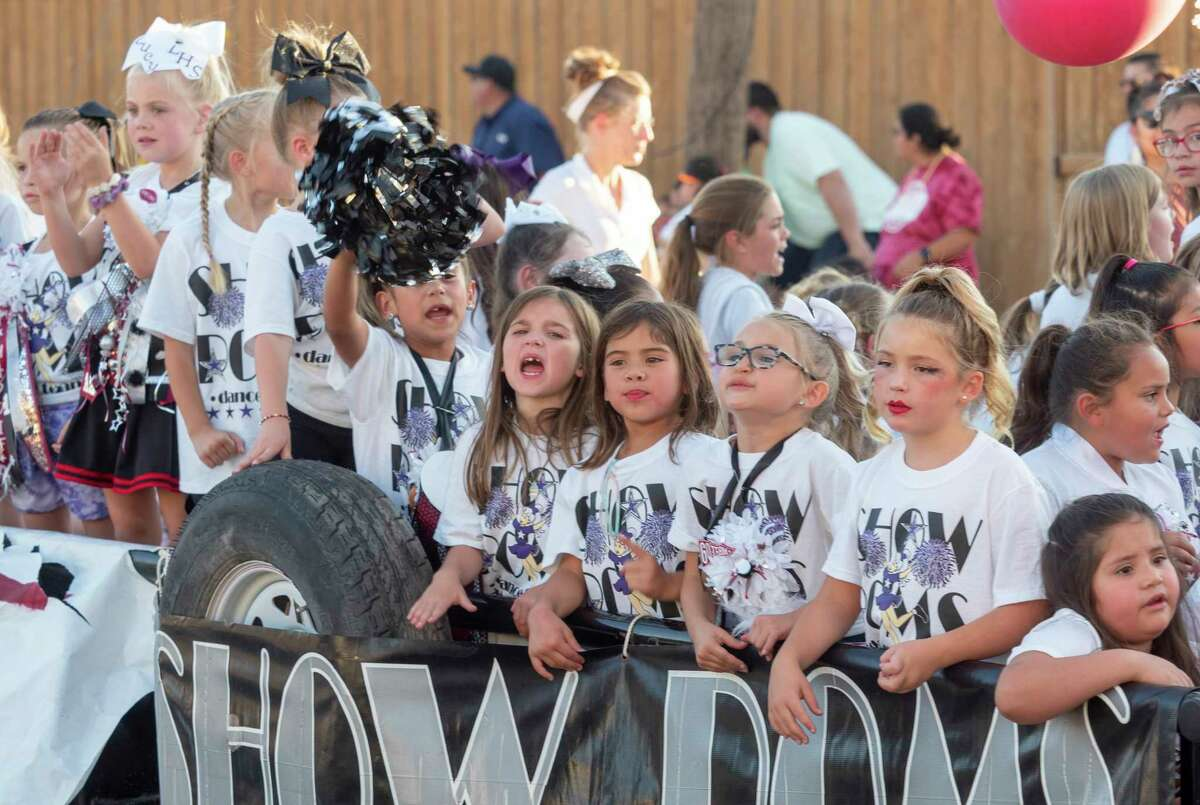 LHS supporters line the streets around Legacy High 10/07/2021 as the homecoming parade makes its way toward the school. Tim Fischer/Reporter-Telegram