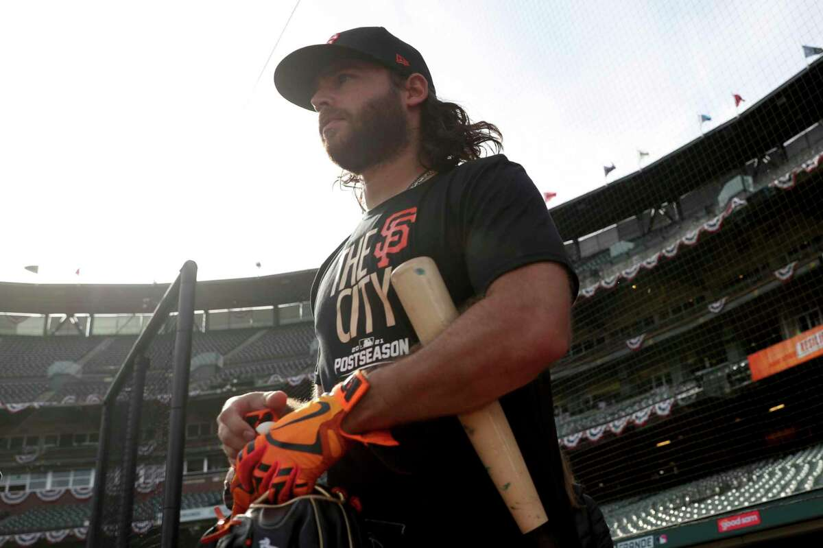 San Francisco Giants' Brandon Crawford enters the field during a workout for the baseball team's National League Division Series against the Los Angeles Dodgers, Thursday, Oct. 7, 2021, in San Francisco. (AP Photo/Jed Jacobsohn)