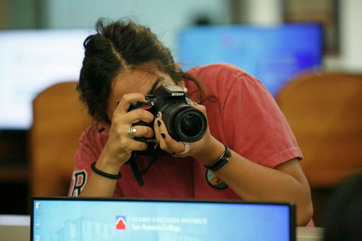 Ranger photographer Veronica Alcorta takes pictures of students working in the San Antonio College Writing Center on Wednesday. The Ranger is set to close in December after 95 years. Alcorta started working for it a week ago.
