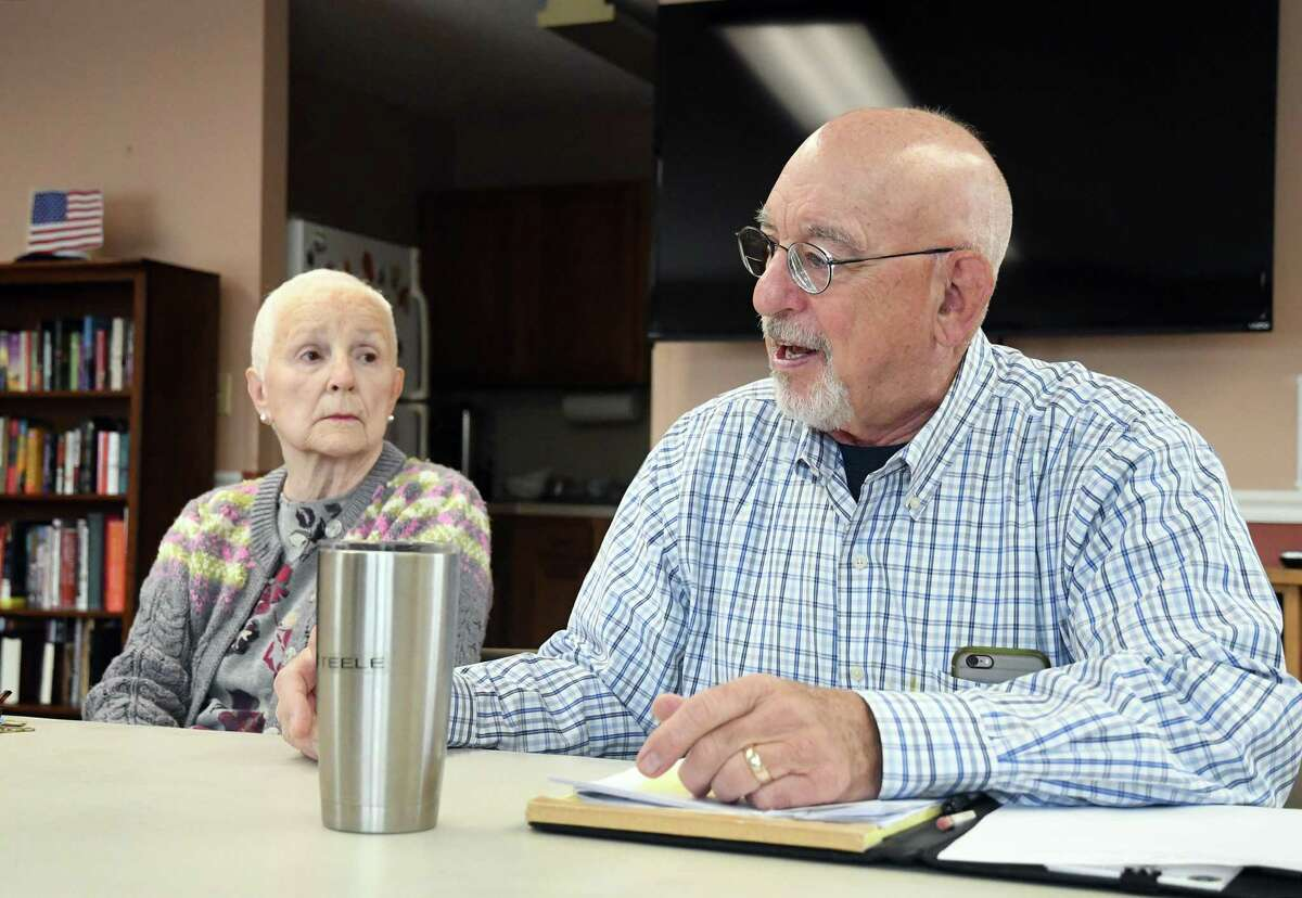 Michael Steele, right, chairman of the Brookfield Housing Authority, along with Brooks Quarry resident Barbara Locke, discuss the complex on May 2, 2019. Brooks Quarry, Brookfield's affordable housing complex, plans to install new sidewalks.