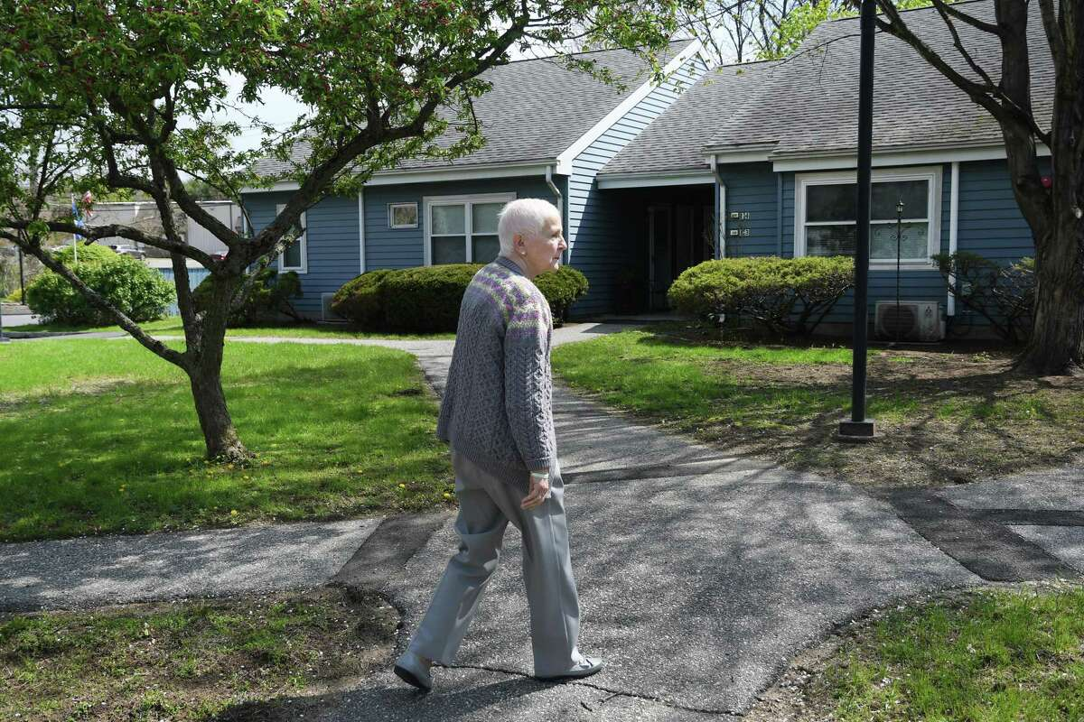 Brooks Quarry resident Barbara Locke walks to her apartment in the Brookfield affordable housing complex on May 2, 2019.
