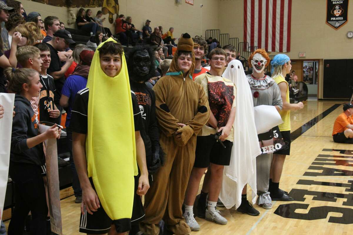 The Harbor Beach student section cheering on the Lady Pirates in the third set.