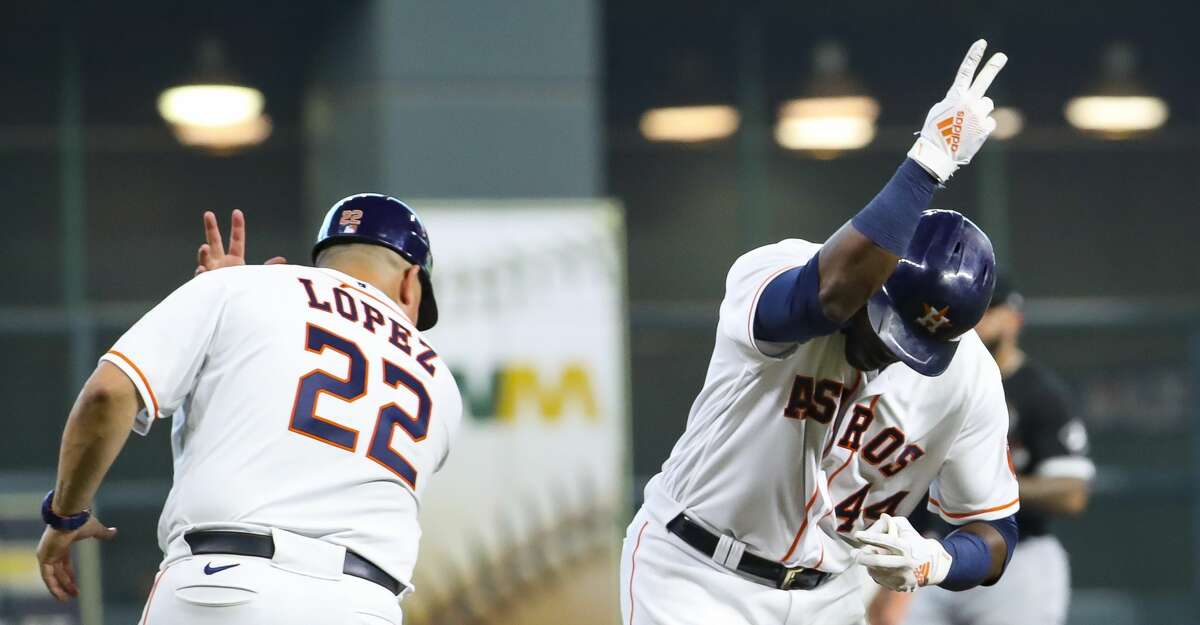 Houston Astros designated hitter Yordan Alvarez (44) rounds the bases past Houston Astros first base coach Omar Lopez (22) after hitting a solo home run to give the Astros a 6-0 lead during the fifth inning in Game 1 of the AL Division Series Thursday, Oct. 7, 2021, in Houston.