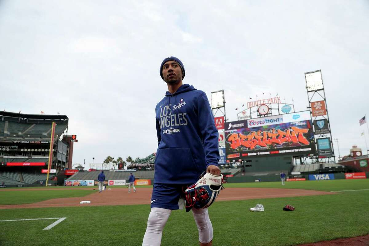 Los Angeles Dodgers' Mookie Betts walks in the infield during a workout Thursday, Oct. 7, 2021, in San Francisco for the baseball team's National League Division Series against the San Francisco Giants, which starts Friday. (AP Photo/Jed Jacobsohn)