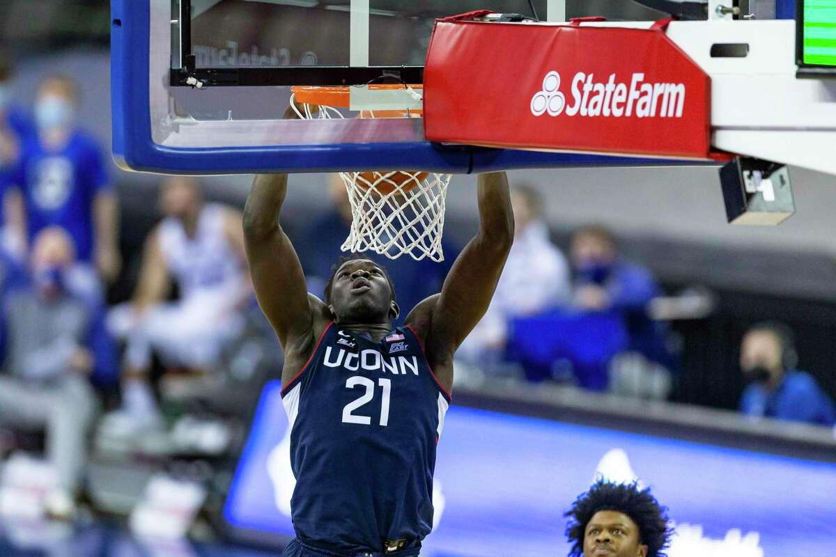 Connecticut forward Adama Sanogo (21) makes a dunk against Creighton in the second half during an NCAA college basketball game Saturday, Jan. 23, 2021, in Omaha, Neb. (AP Photo/John Peterson)