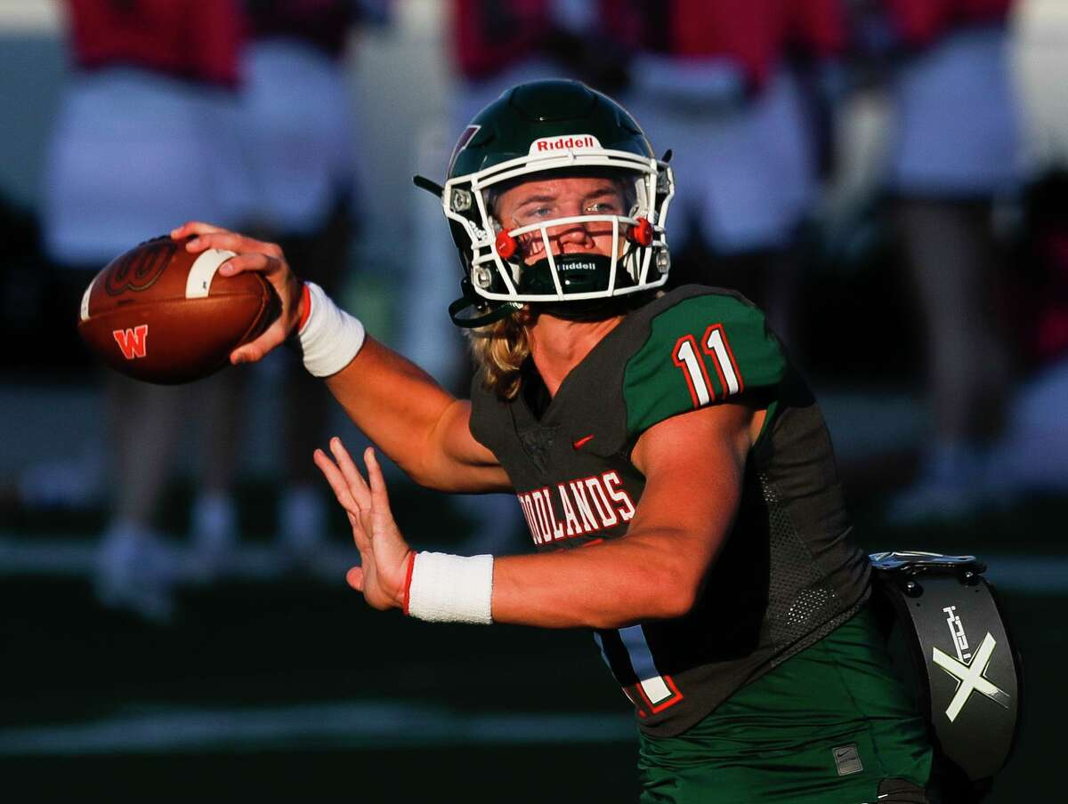 The Woodlands quarterback Mabrey Mettauer (11) warms up before a District 13-6A high school football game at Woodforest Bank Stadium, Thursday, Oct. 7, 2021, in Shenandoah.