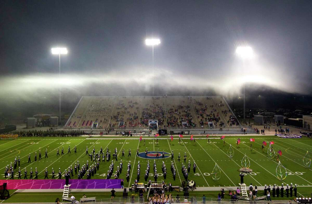 Fogs sits above The Woodlands High School band during halftime of a District 13-6A high school football game at Woodforest Bank Stadium, Thursday, Oct. 7, 2021, in Shenandoah.