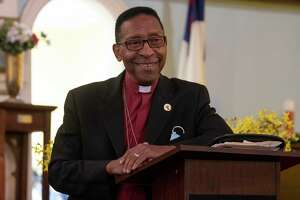 Dr. Bishop Norman Macklin of New Jerusalem Missionary Baptist Church, the chaplain to the Troy police and fire departments, is seen at New Jerusalem Missionary Baptist on Monday, Oct, 4, 2021 in Troy, N.Y.