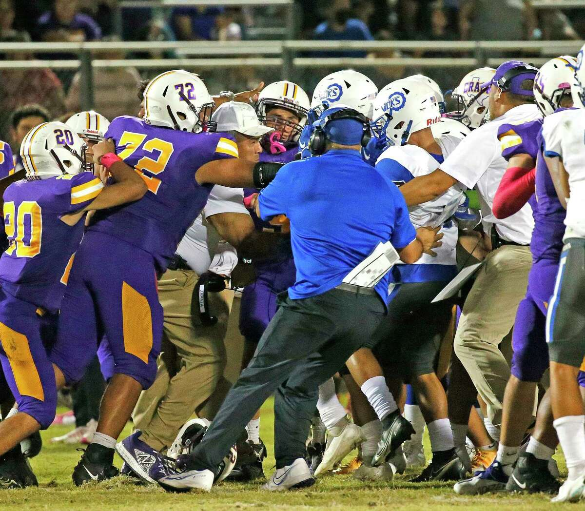 Coaches try to separate the teams after tempers got out of control in the fourth quarter. Lanier defeated Brackenridge 21-14 at SAISD Complex on Friday, September 17, 2021.