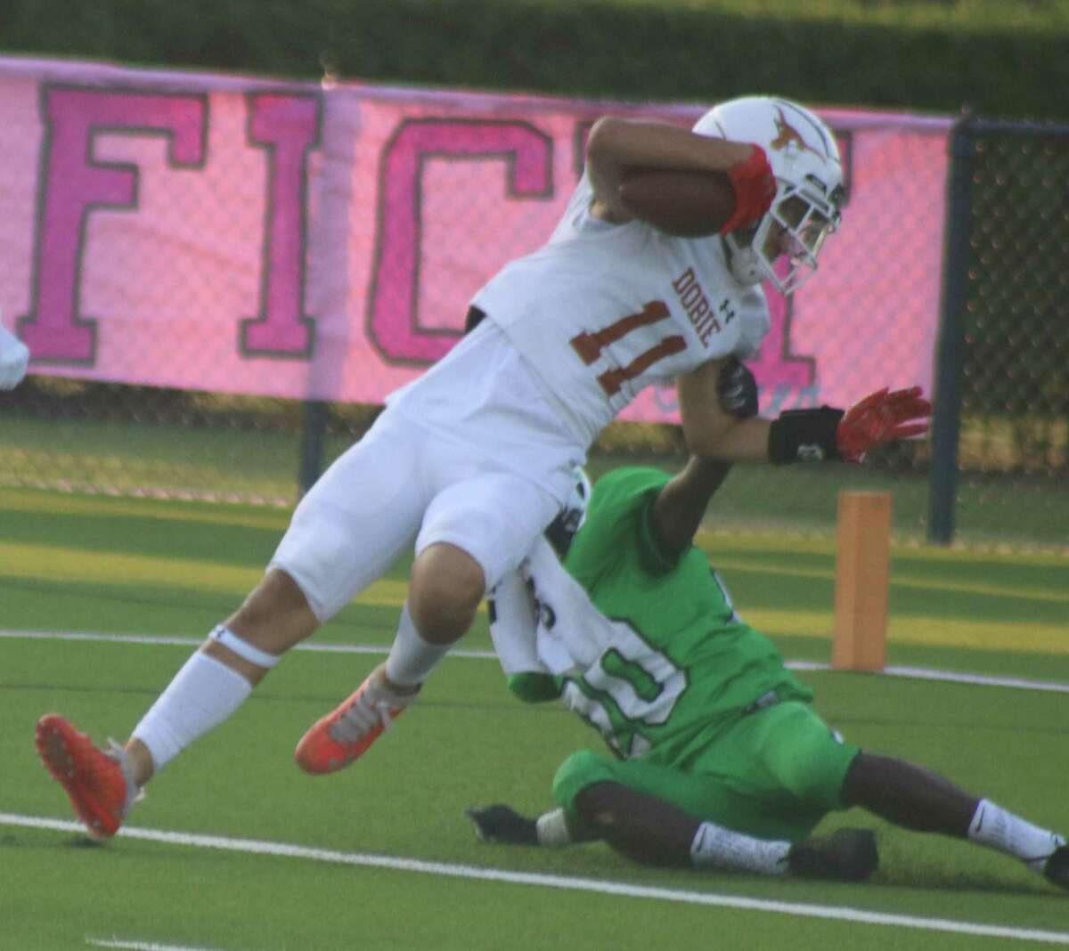 Dobie receiver Joshua Rodriguez scores the first of his two touchdown receptions Thursday night, a 51-yarder that upped the lead to 14-0.