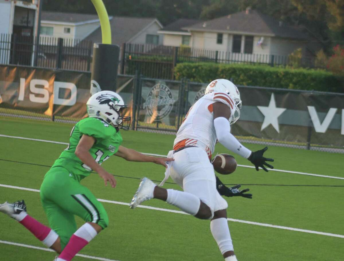 Dobie's Brendonn Williams can't quite hold on to this long pass attempt from quarterback Cameron Gray. No matter, the running game scored on the very next play to make it 28-0.