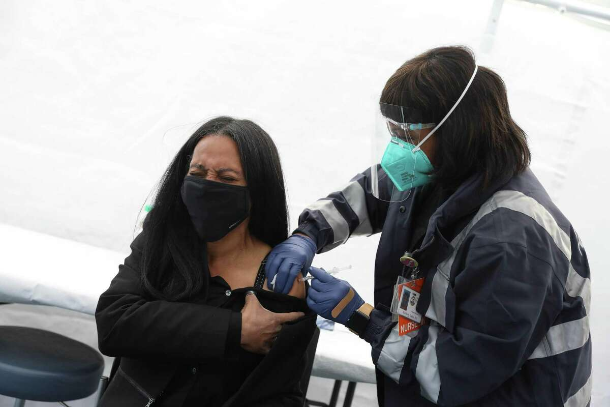 Kimberly Tucker (right), SFDPH nurse, gives Sheryl Davis, Human Rights Commision director (left) the Johnson and Johnson COVID-19 vaccine at a vaccine clinic on March 16, 2021 in San Francisco.