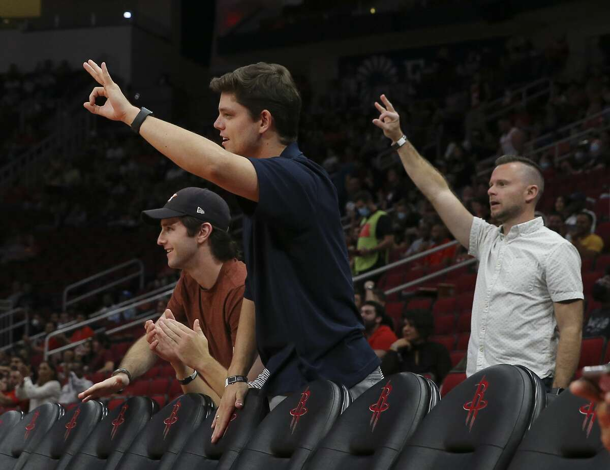 Houston Rockets fans celebrate a three point basket against the Miami Heat during the first quarter of a NBA preseason game Thursday, Oct. 7, 2021, at Toyota Center in Houston.
