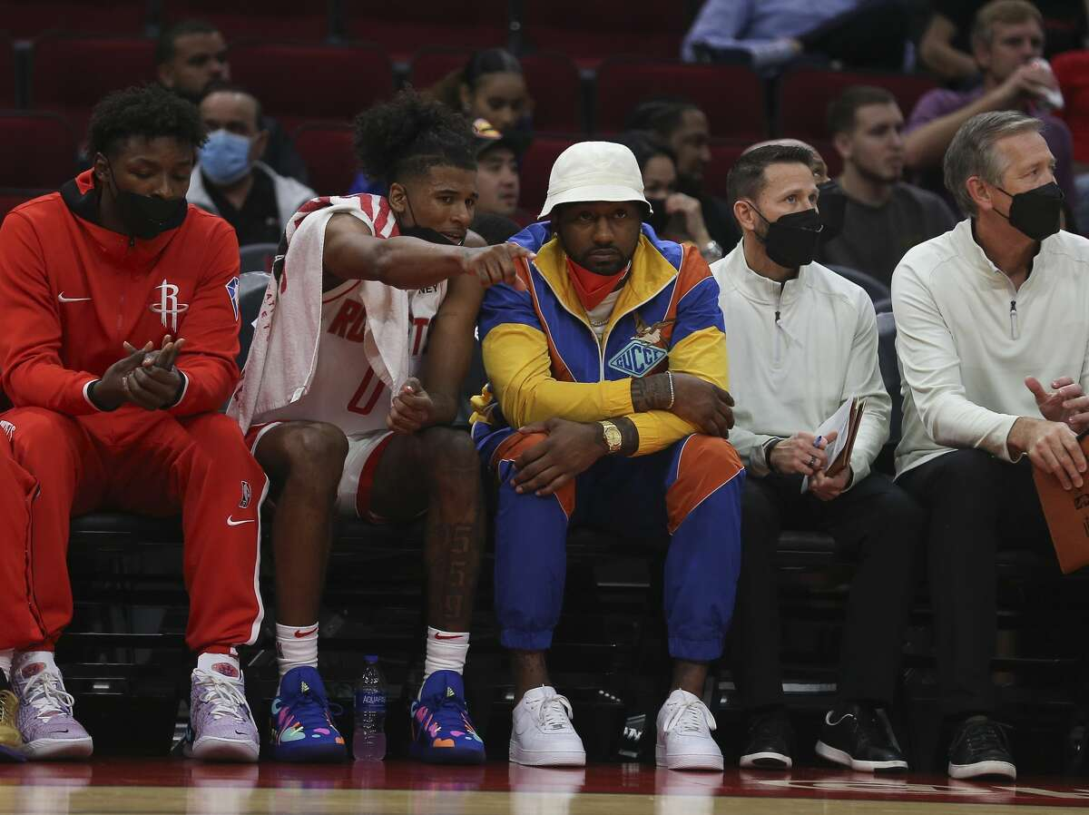 Houston Rockets guard Jalen Green (0) and John Wall (1) have a conversation on the sideline during the first quarter of a NBA preseason game against the Miami Heat Thursday, Oct. 7, 2021, at Toyota Center in Houston.