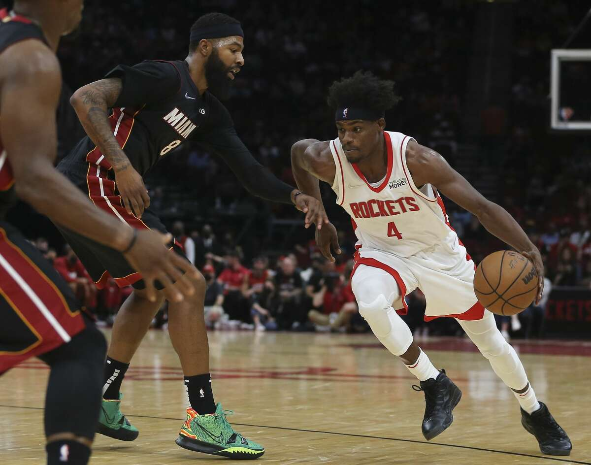 Houston Rockets forward Danuel House Jr. (4) dribbles toward the basket during the second quarter of a NBA preseason game against the Miami Heat Thursday, Oct. 7, 2021, at Toyota Center in Houston.