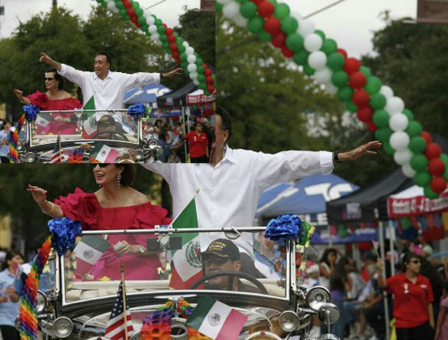San Antonio District 1 Councilwoman Mary Alice Cisneros and former Mayor and HUD Sectretary Henry Cisneros wave to the crowd during the Guadalupe Avenue Association's 16 de Septiembre parade and festival at Guadalupe Plaza in San Antonio.
